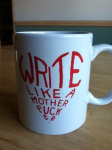 "coffee cup that says ""write like a motherfucker"""